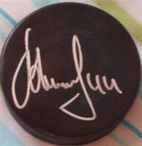 Alexei Zhitnik autographed hockey puck