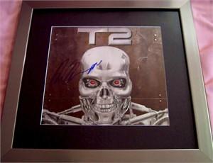 Arnold Schwarzenegger autographed Terminator 2 embossed logo matted & framed