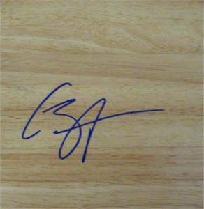Caron Butler autographed basketball hardwood floor