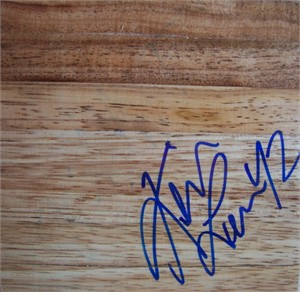 Kevin Love autographed basketball hardwood floor
