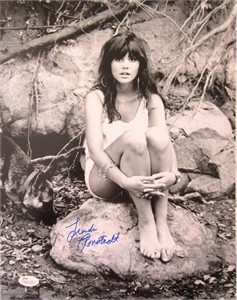 Linda Ronstadt autographed 11x14 black and white photo sitting on rock (JSA)
