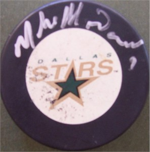 Mike Modano autographed Dallas Stars puck