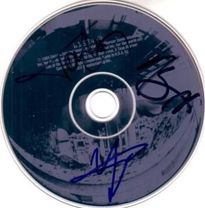 Tommy Lee Vince Neil Nikki Sixx autographed 1994 Motley Crue CD