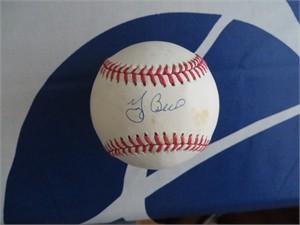 Yogi Berra autographed American League baseball (discolored)