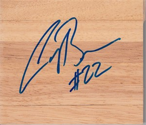 Corey Brewer autographed basketball hardwood floor