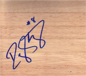 D.J. Strawberry autographed basketball hardwood floor