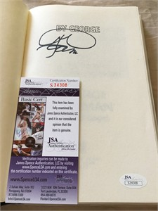 George Foreman autographed By George hardcover book (JSA)
