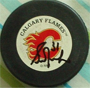 Grant Fuhr autographed Calgary Flames puck