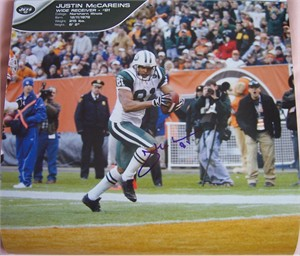 Justin McCareins autographed New York Jets calendar page