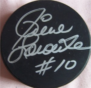 Pierre Larouche autographed hockey puck