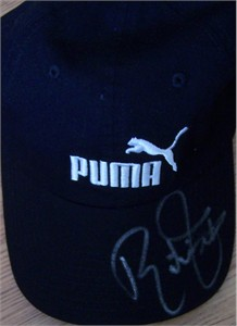 Rickie Fowler autographed black Puma golf cap or hat