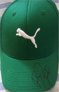 Rickie Fowler autographed green Puma golf cap or hat
